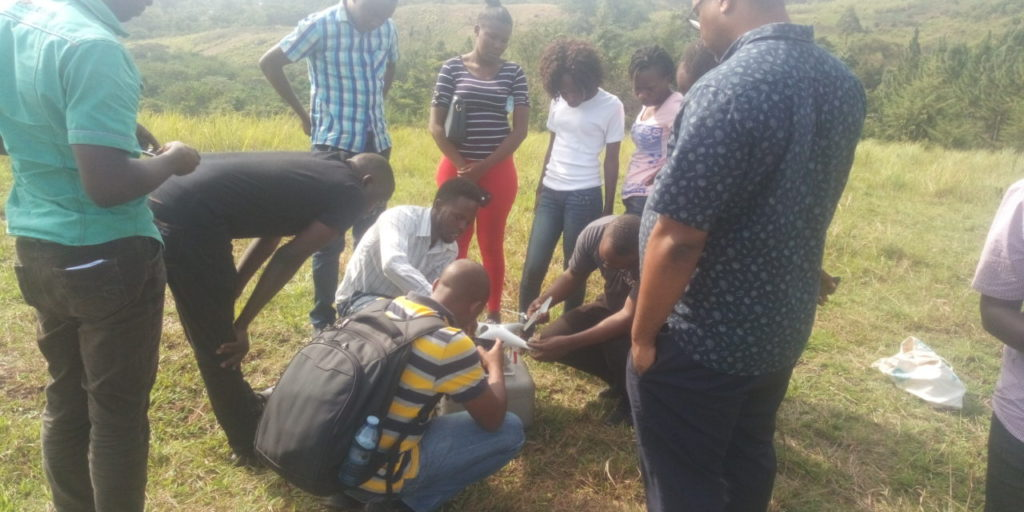 The instructor and participants assembling the drone.