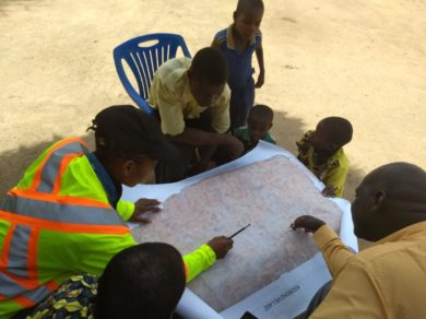 Citizens of Ng'hoboko Village assisting us and each other to identify their farms.