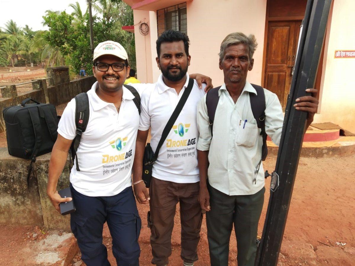 Laxman Aroskar flanked by his team