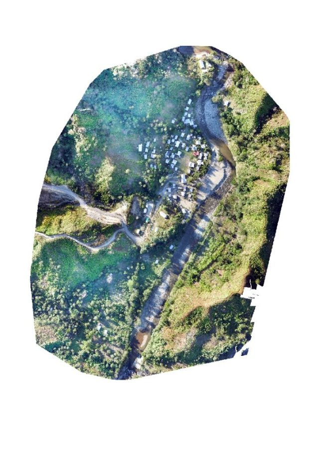 An aerial view of the affected village after the landslide was cleared off