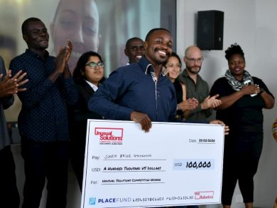 Sikem Brice Nyuykonghi Accempting His Prize