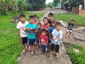 Children holding Mavic 2 enterprise dual after drone parts lesson and flight demonstration.