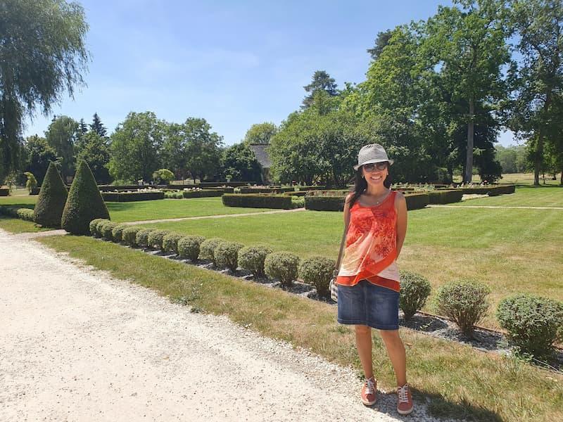 Wee Kheng Yuen seen along a dirt road in a grassy park