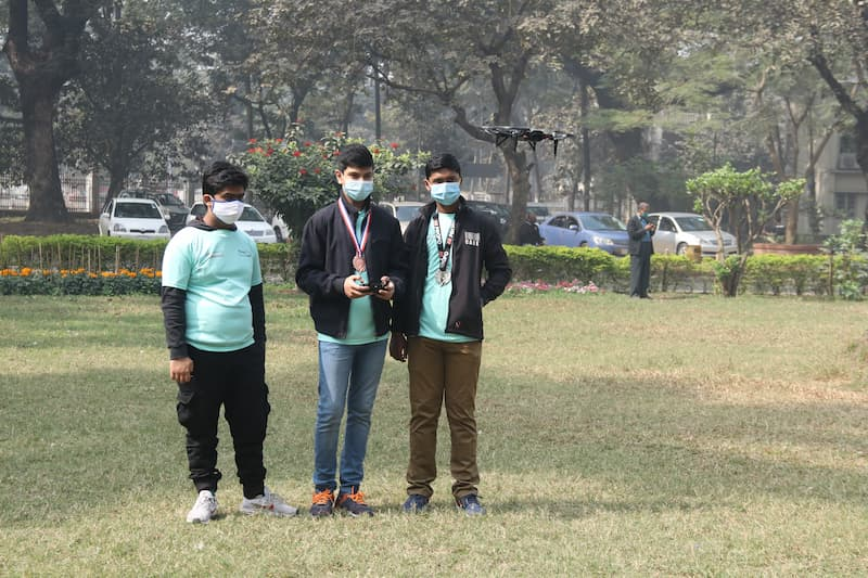 Bangladesh Flying Labs STEM Program: A group of boys fly a drone
