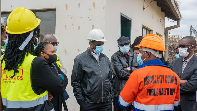 Zambia Flying Labs and partners reviewing the site for a waste management project